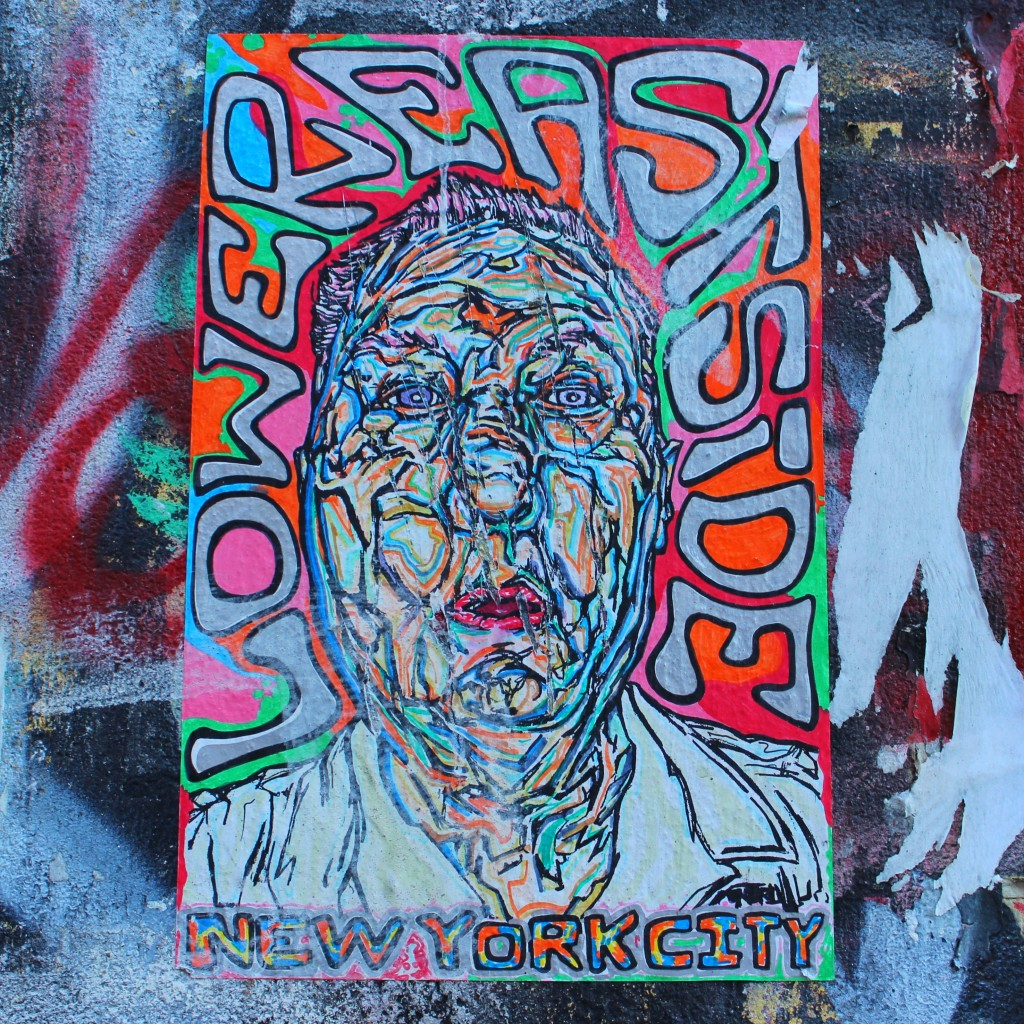 Colorful fumeroism wheat paste up in soho in new york city on the public art gallery on the corner of bowery and spring street, street art, graffiti