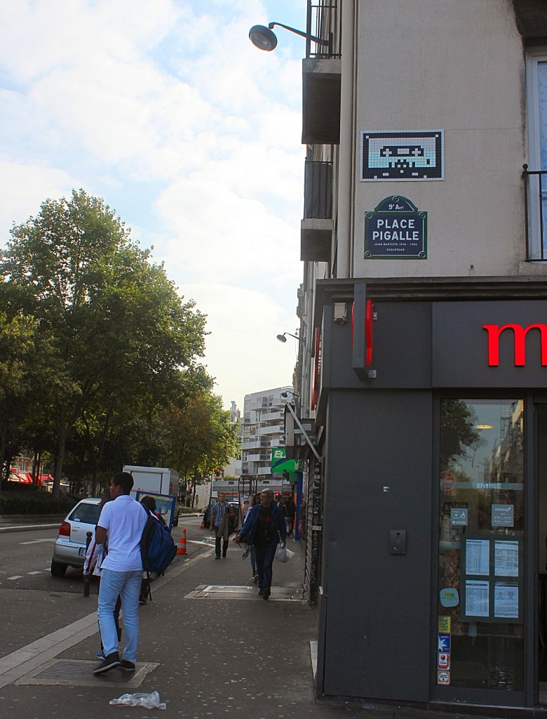 Spaceinvader casette mosaic in Place Pigalle in Paris, street art, public space take over