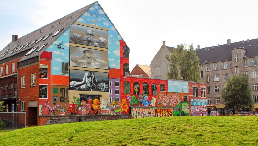 colorful graffiti and street art covered building in nørrebro in copenhagen