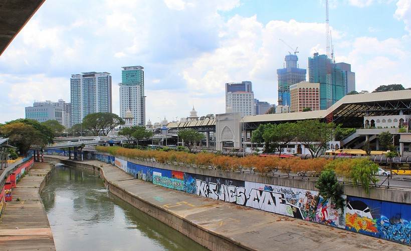 By the river getting of the train in kuala lumpur there's this long mural full of graffiti and street art, perfect public space take over