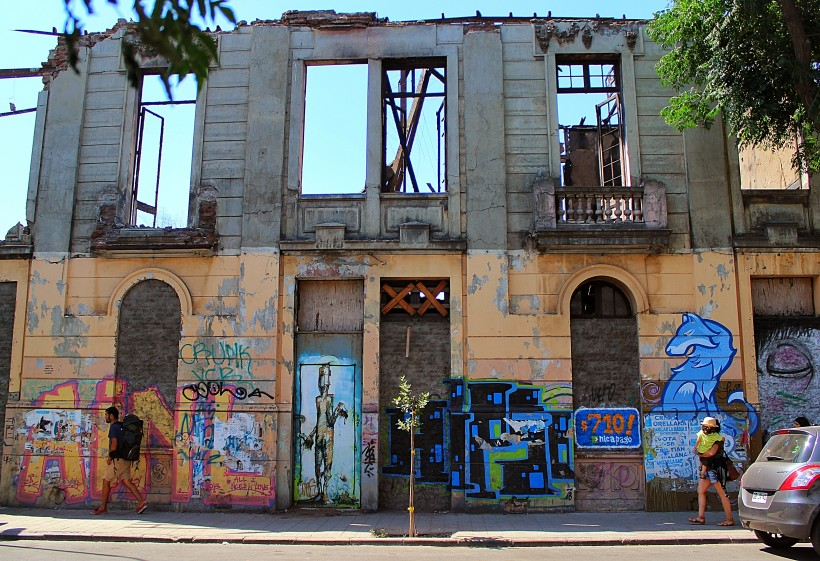 amazing abandoned house covered in graffiti and street art in barrio yungay in santiago de chile, public space take over, tags and throws