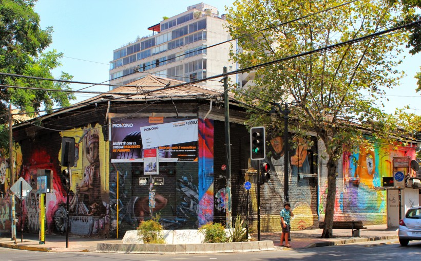 amazing street corner full of street art and graffiti in barrio bellavista in santiago de chile, public space take over with murals and tags and throws