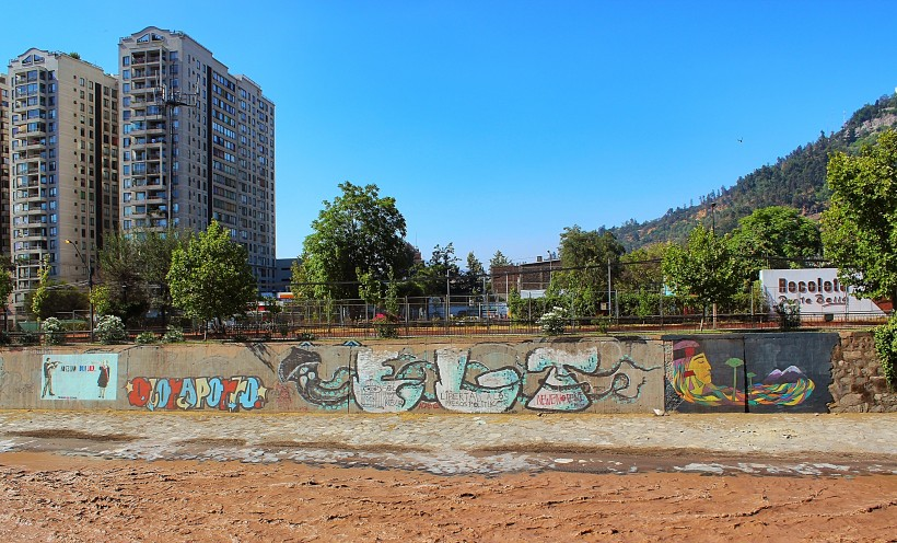 public space take over along side the river mapocho in santiago de chile, street art and graffiti and tags and throws