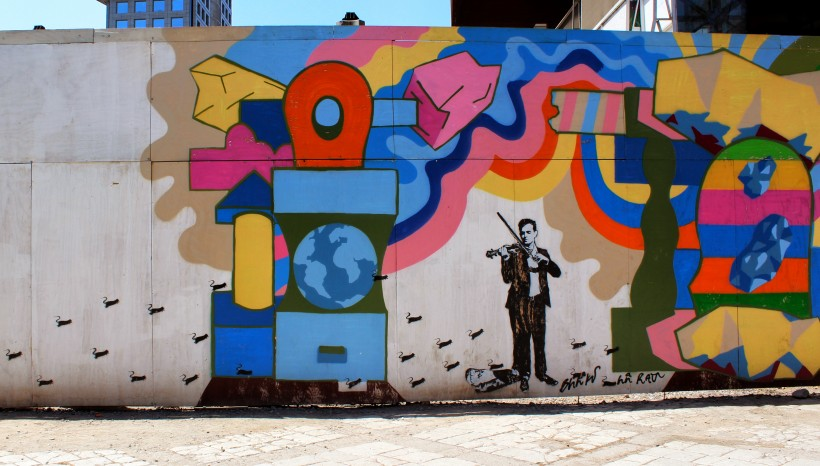 a huge mural by blek le rat in barrio lastarria in santiago de chile, public space take over with street art and graffiti, tags and throws