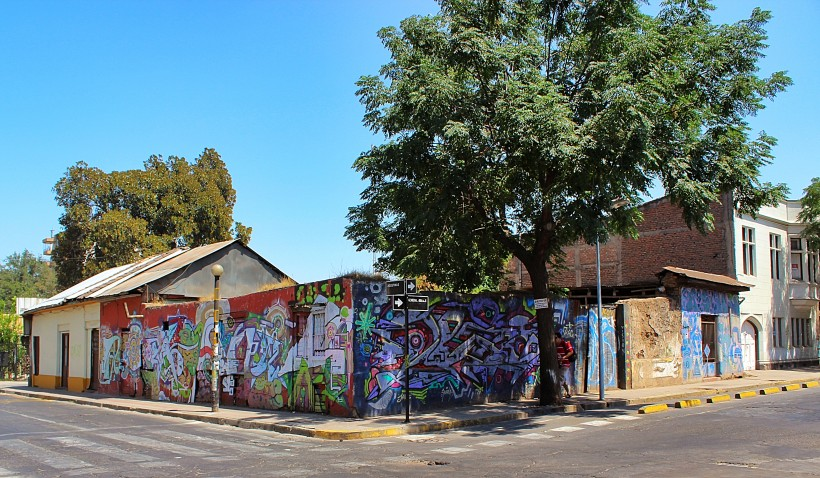 beautiful and colorful graffiti and street art in barrio brazil in santiago de chile, public space take over with tags and throws