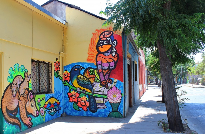 colorful mural in barrio yungay in santiago de chile, street art, graffiti, public space take over
