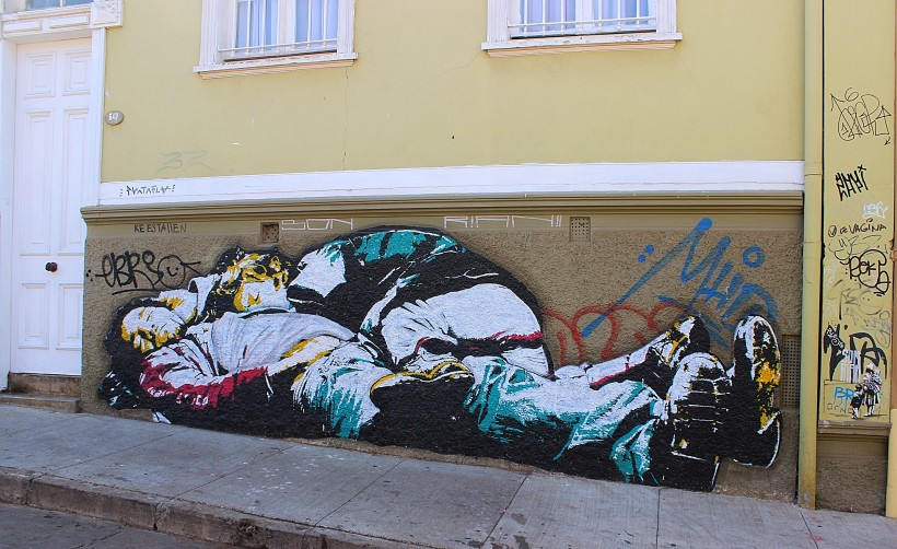 beautiful street art in cerro alegre in valparaiso in chile, publics space take over with murals and graffiti and tags and throws