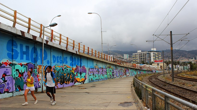 By the tram tracks at Barón station in valparaiso full of graffiti, public space take over with street art and tags and throws