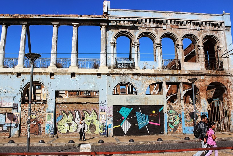abandoned ruins with street art and graffiti on them in valparaiso in chile, public space take over, tags and throws
