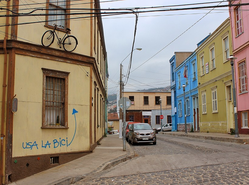 public space take over with a sense of humor in valparaiso in chile, street art and graffiti with tags and throws